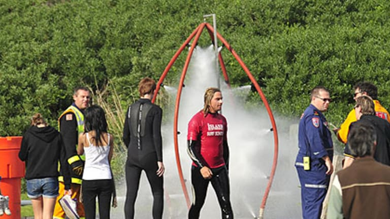School students at Smiths Beach on Phillip Island had to have emergency decontamination showers.