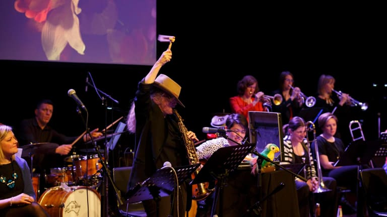 Sandy Evans whoops it up with members of the Sirens Big Band.