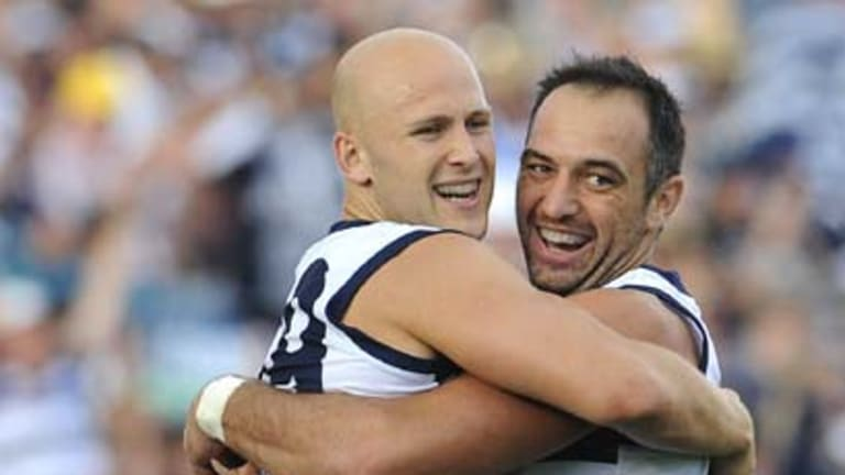 Gary Ablett and James Podsiadly lap it up.