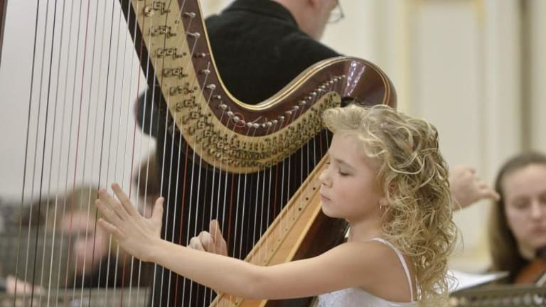 Something extraordinary: harpist Alisa Sadikova, 11, will perform at City Recital   Hall with three other internationally renowned harpists.