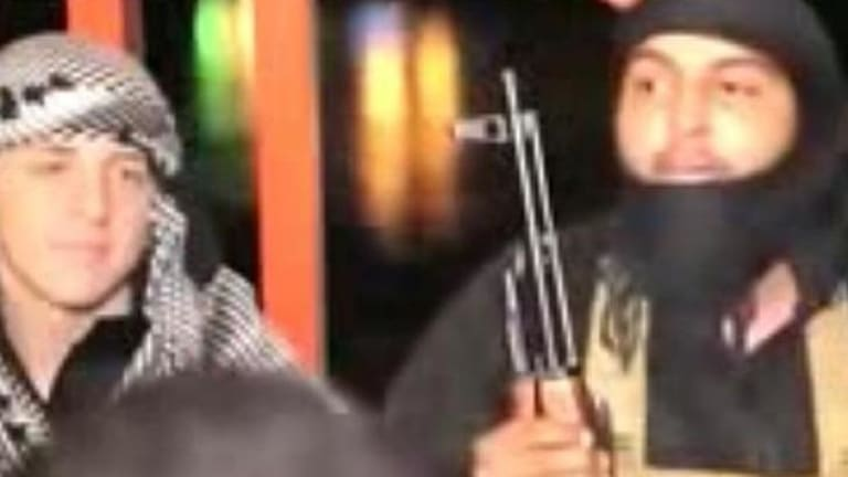 Abdullah Elmir appears in his latest Islamic State video.
