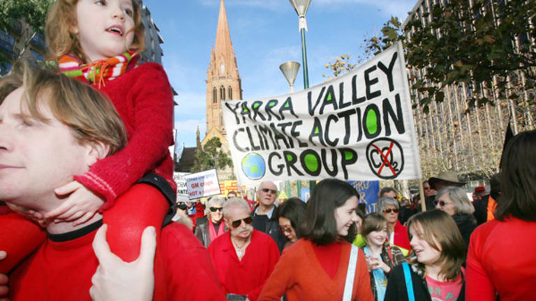 Demonstrators on their way to the Alexandra Gardens to spell out a climate warning.