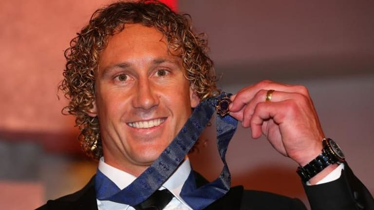 Matt Priddis poses with the 2014 Brownlow Medal after winning the honour on Monday night.