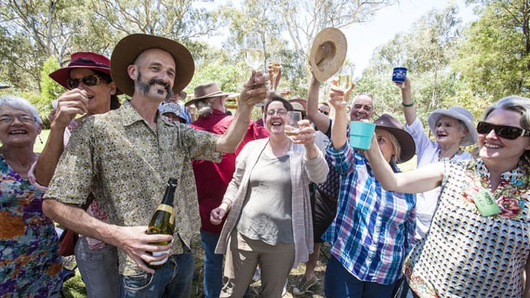 Locals and renewable energy supporters celebrate   the approval of the Cherry Tree wind farm near Seymour earlier this month.