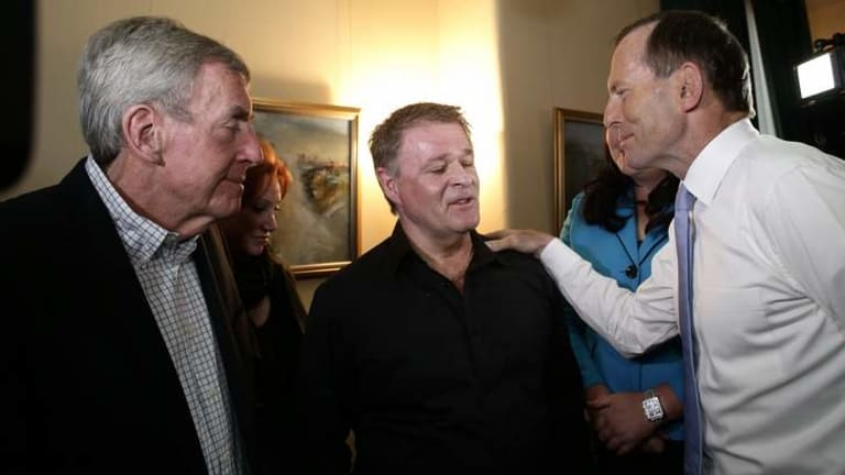 Opposition Leader Tony Abbott meets Bali bombing survivors Paul Anicich, left, and Peter Hughes, centre.