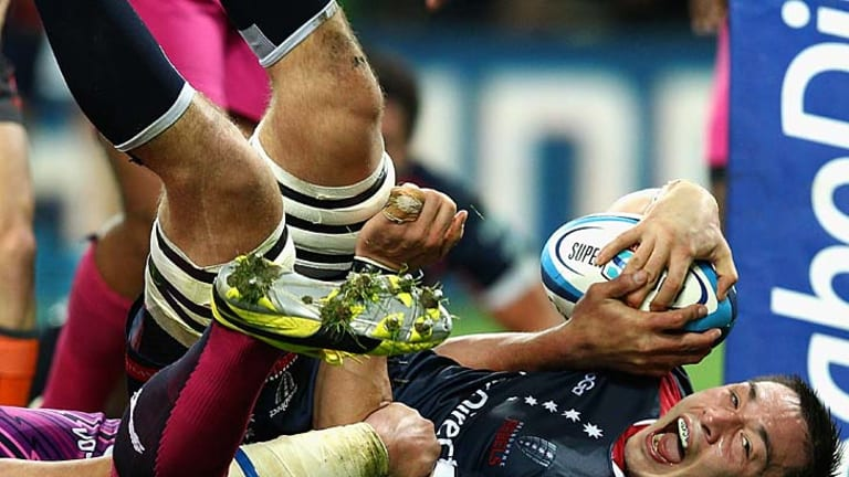Gareth Delve of the Rebels scores a try after the halftime siren.