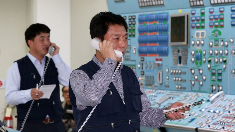 On alert ... South Korean employees conduct a simulated drill to ensure the safety of nuclear power plants under cyber attacks, at a training center of the Wolseong Nuclear Power Plant in the southeastern city of Gyeongju on Monday.