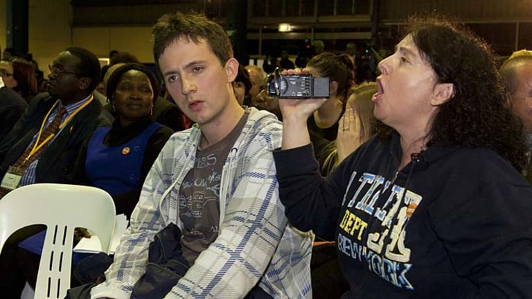 Jordan Nash, 22, (left) sits while his mother Jennifer heckles Prime Minister Julia Gillard during a public forum in Ipswich, west of Brisbane.