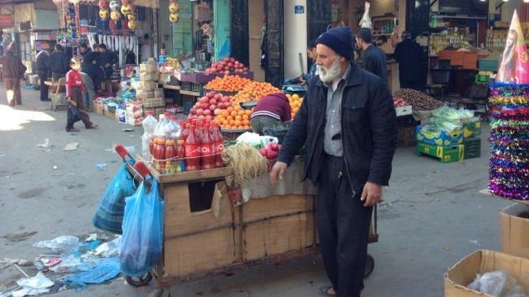 A stallholder at markets in Gaza City.