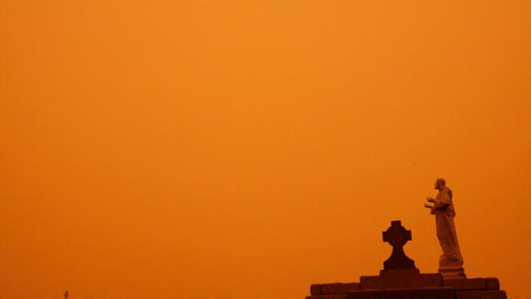 The dust storm leaves an eerie red hue over Waverley cemetery in Sydney.