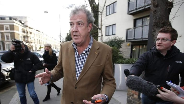 Polarising figure ... British television presenter Jeremy Clarkson leaves his London home on Tuesday. Nearly 450,000 fans from around the world have backed a petition calling for Clarkson to be reinstated to his job hosting Top Gear.