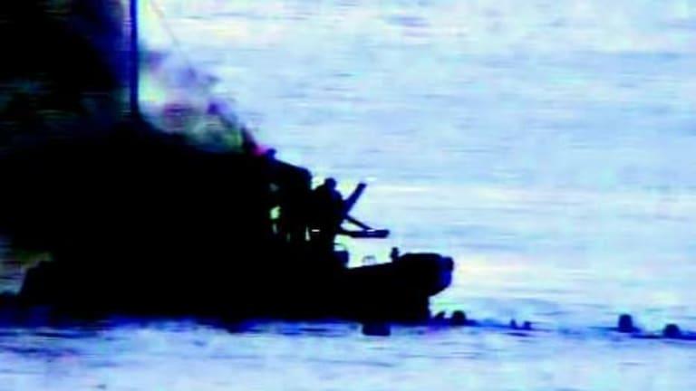 The SIEV 36 ablaze off the coast of Australia.