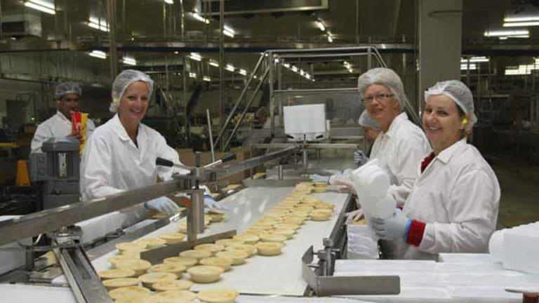 """At Pattie Foods bakery in Bairnsdale it's a matter of """"go pies"""" by the thousand to feed the grand final crowd."""