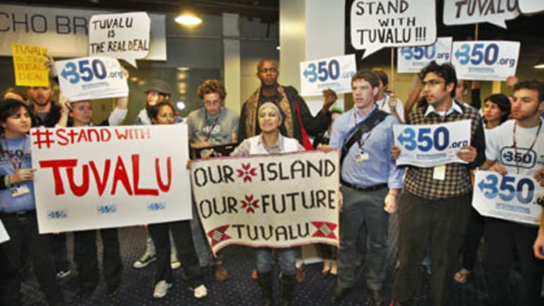 Standing up for Tuvalu ... activists made their point, loud and clear, as delegates arrived at the copnference on Wednesday.