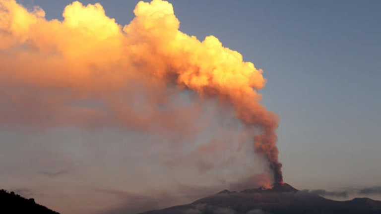 Smoke billows from Mount Etna volcano, as seen from the village of Viagrande, near the Sicilian town of Catania.