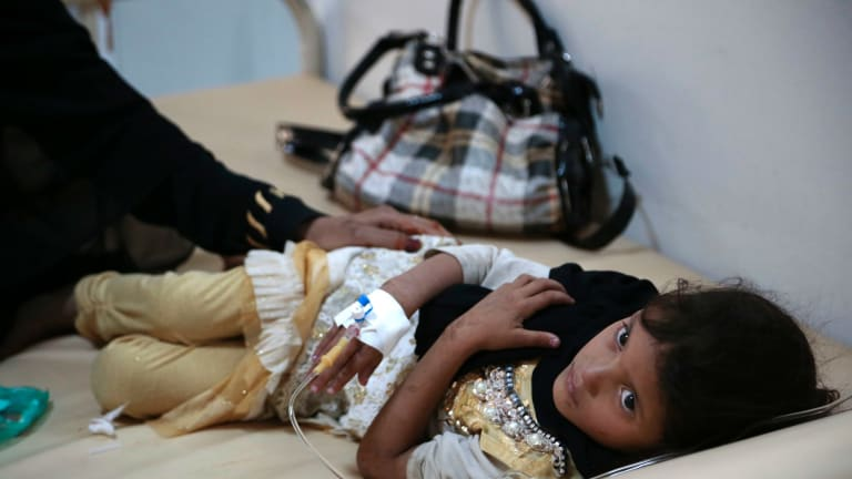 A girl is treated for a suspected cholera infection at a hospital in Sanaa, Yemen, in July.