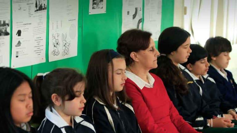 Students practise transcendental meditation at the Maharishi School in Reservoir.