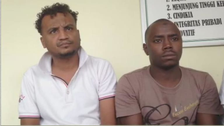 """Abdullah Ahmed,  left,  from Eritrea was on the  boat. He did not see the incident because he was on the top deck, but the hand-burning story had immediately spread among the passengers. """"I saw people with burned hands.  They said, 'Don't go to the toilet, it's punishment from the navy'."""""""