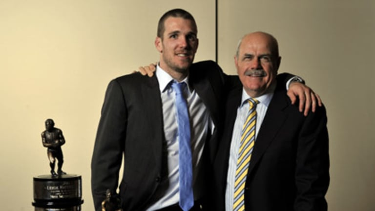 Dane Swan (left), the winner of the AFL Players Association's Most Valuable Player award, is congratulated by AFL legend Leigh Matthews, after whom the trophy is named.