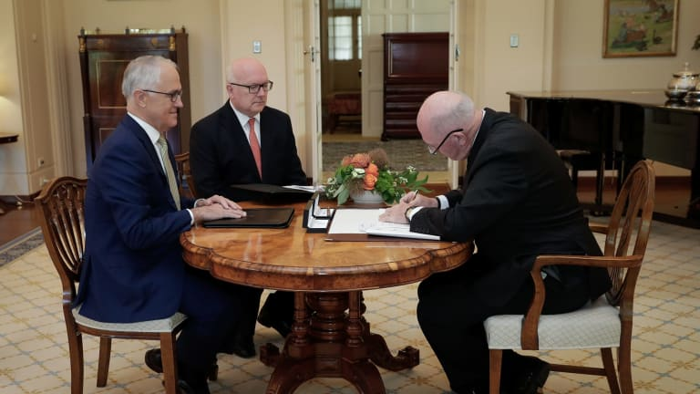 Prime Minister Malcolm Turnbull, Attorney-General George Brandis and Governor-General Sir Peter Cosgrove during a ceremony for the assent of the bill.