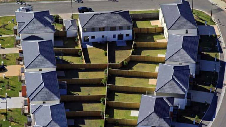 """""""This [Boomburbs] exhibition gives a fascinating bird's-eye view ... while putting Sydney's housing issue under the spotlight"""" ...  houses in Woodcroft."""