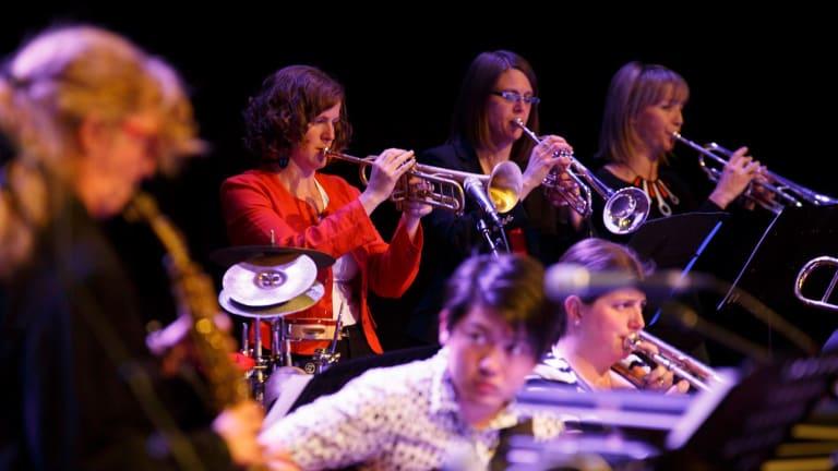 Composer Ellen Kirkwood (in orange) with members of the Sirens Big Band.