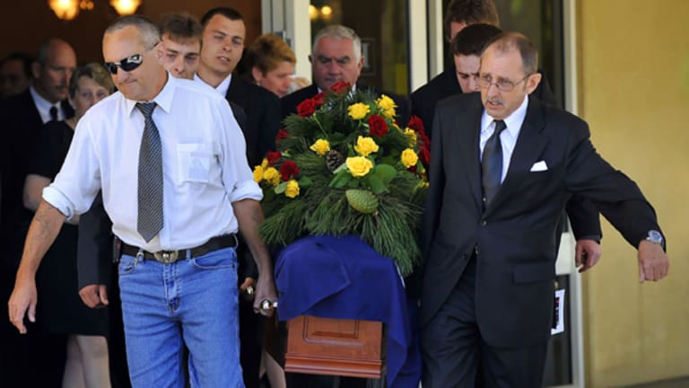 Sons Barry (left) and Ian carry the coffin of their father, William Ellis Green.