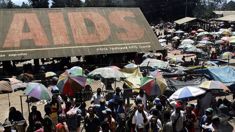 An AIDS public awareness campaign dominates the roof of Goroka's central market.