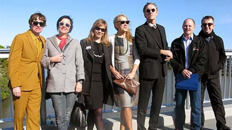 Members of the Go-Betweens join with Lord Mayor Campbell Newman (second from right) to celebrate the impending opening of the Go Between Bridge.