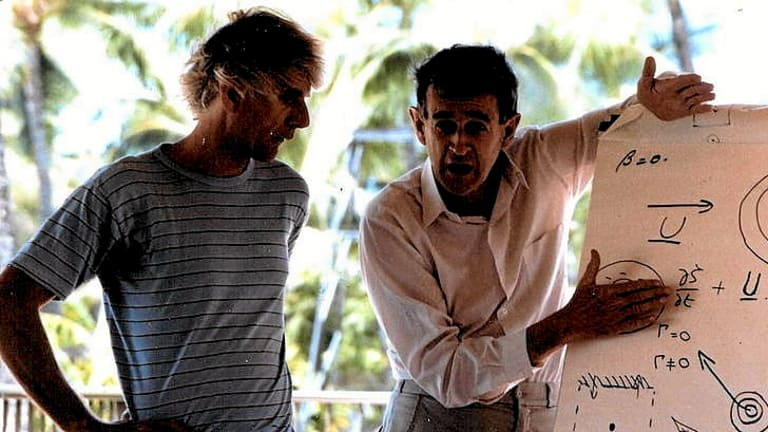 Bruce Morton in Hawaii in 1989, speaking at an outdoor meeting on a project to study tropical cyclone motion. On the left is Roger Smith, a co-author of this obituary.