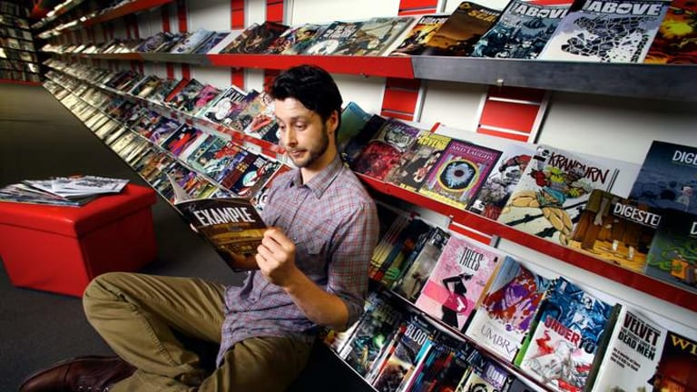 All Star Comics has won the Eisner award for world's best comic store.  Co-owner Mitchell Davies in the Lonsdale Street store.