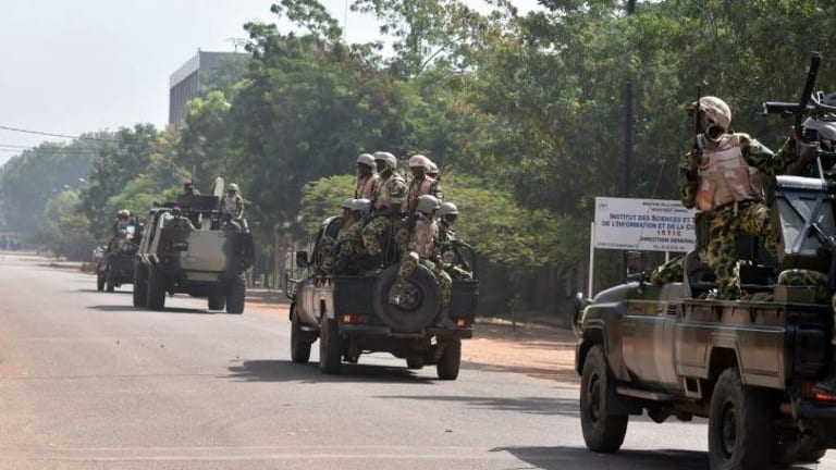 The cavalry arrives: Burkina Faso troops ride into town.