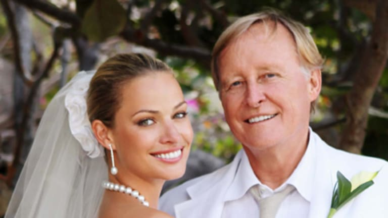 Beauty and the geek ... Kristy Hinze and Jim Clark on their wedding day.