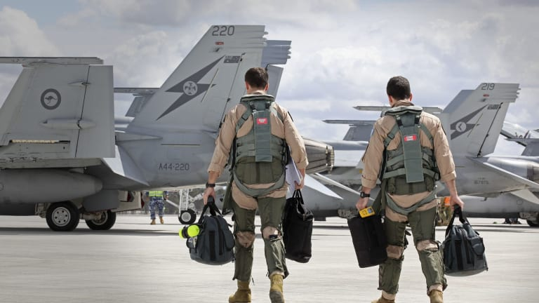 In this handout image provided by Commonwealth of Australia, F/A-18F Super Hornet aircrew head to their aircraft in preparation for departure to the Middle East from RAAF Base Amberley on September 21, 2014 in Amberley, Australia.