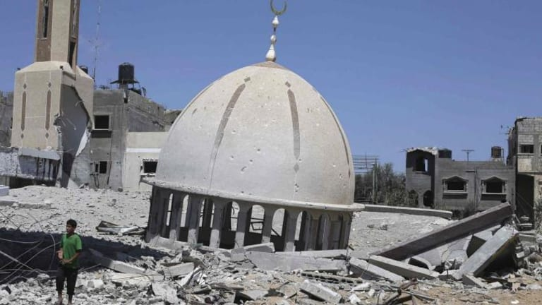 The remains of a mosque in Khuza'a, Gaza.