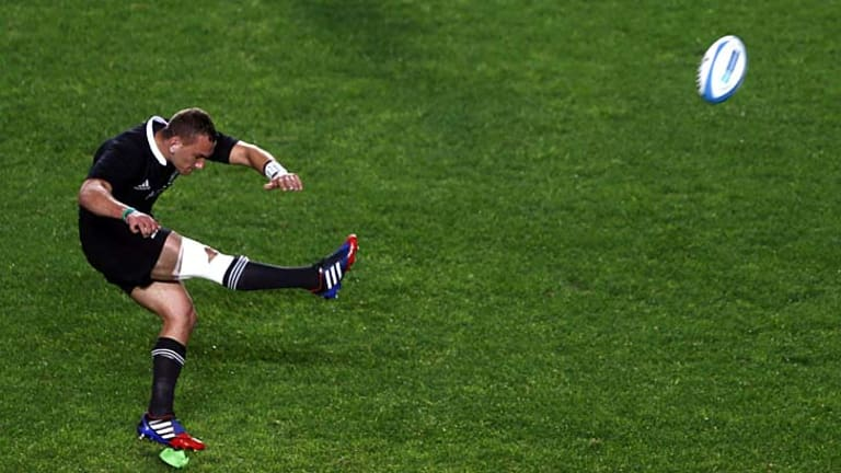 All Blacks' five-eighth Aaron Cruden takes a penalty during the Rugby Championship match against Argentina on the weekend. He was distracted by a laser pointer from the crowd.