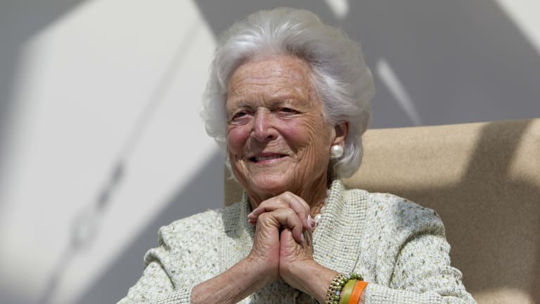 Former first lady Barbara Bush listens to a patient's question during a visit to the Barbara Bush Children's Hospital in Portland, Maine, in 2013.