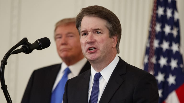 US President Donald Trump listens as Brett Kavanaugh, his Supreme Court nominee, speaks during an event in the East Room of the White House, Monday.