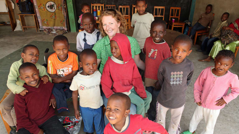 Sarah Rejman pictured in 2010 with child patients of the Plaster House in Arusha, Tanzania, which she founded in 2008.