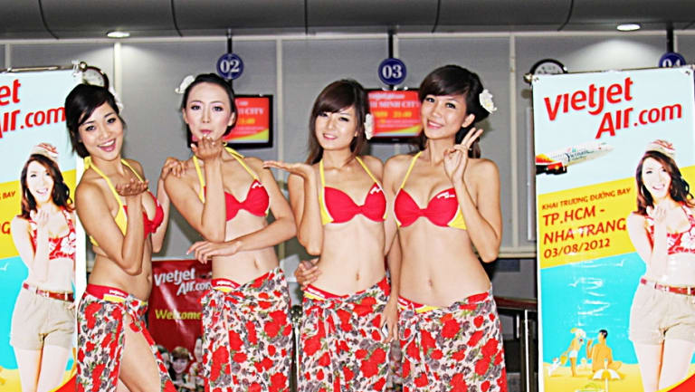 VietJet is known for its young flight attendants who wear bikinis on inaugural flights to beach locations.