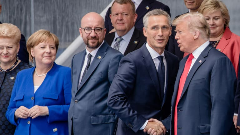 Jens Stoltenberg, secretary general of the NATO, second right, shakes hands with US President Donald Trump as Angela Merkel, Germany's chancellor, second left, Charles Michel, Belgium's prime minister, second left, watch.