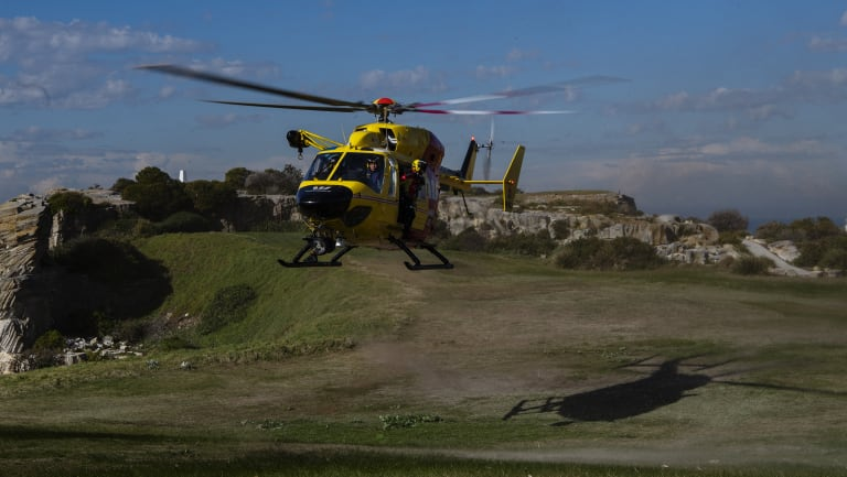 The Westpac Lifesaver Rescue Helicopter landing at Bondi Beach Golf Club