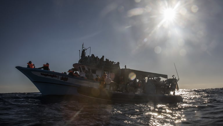 In this file photo from January, 329 migrants wait to be rescued by aid workers after leaving Libya. The North African nation is the main gateway for migrants trying to cross to Europe by sea.