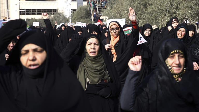 Iranian hard-liners rallied Saturday to support the country's supreme leader and clerically overseen government as spontaneous protests sparked by anger over the country's ailing economy roiled major cities in the Islamic Republic.