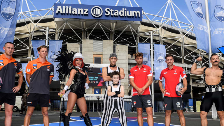 AFL players Tom Scully and Lachie Whitfield (left), of the Greater Western Sydney Giants, with Dane Rampe and Jake Lloyd (right), from the Sydney Swans, stand with circus performers at the announcement of the 2018 AFLX tournament.