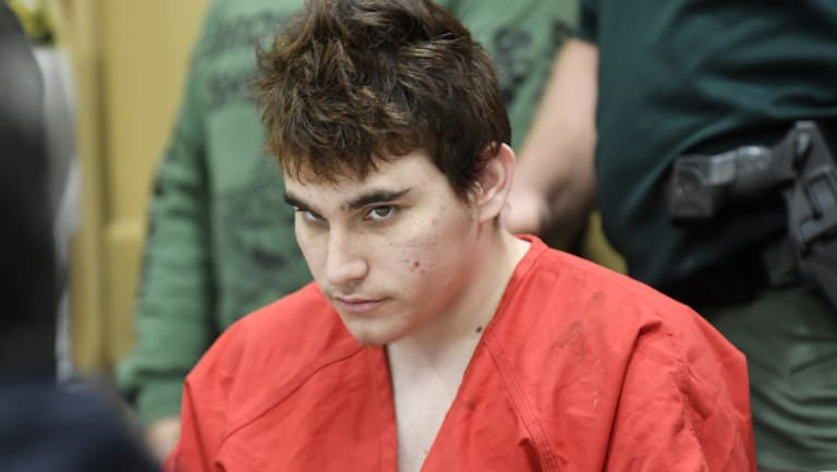 Florida school shooting suspect Nikolas Cruz, looks up while in court for a hearing in Fort Lauderdale, Florida.