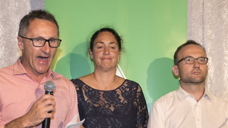 Greens leader Richard Di Natale concedes defeat next to candidate Alex Bhathal.