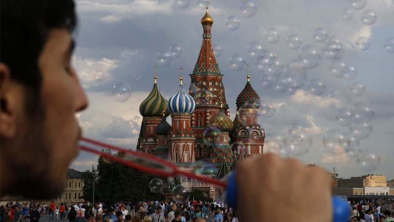 A young man blows bubbles in Red Square during the 2018 soccer World Cup in Moscow.