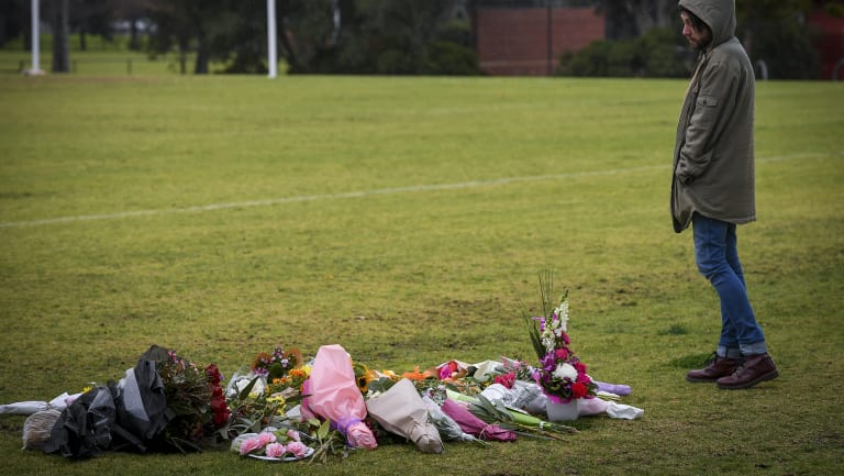 Dylan Scolyer, a friend of Eurydice Dixon, pays tribute to her at the Princes Park on Friday morning.