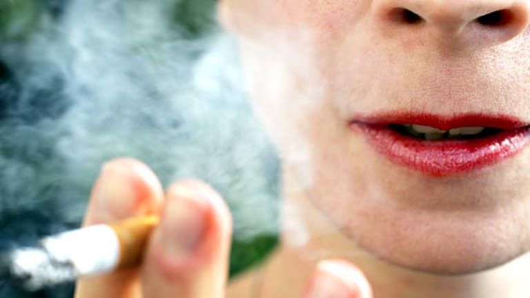 More than 100 Queenslanders have been fined since laws were introduced banning smoking near bus stops, taxi ranks and ferry terminals.